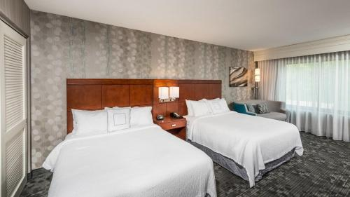 A bed or beds in a room at Courtyard Bangor