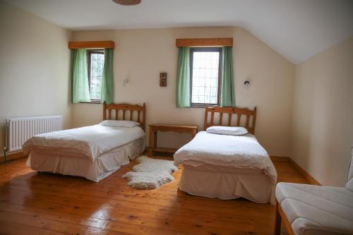 A bed or beds in a room at Killeena House