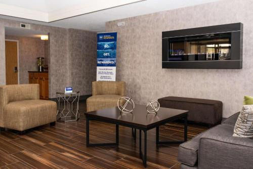 A seating area at Best Western University Inn