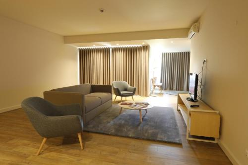 Uma área de estar em Montebelo Aguieira Lake Resort & Spa