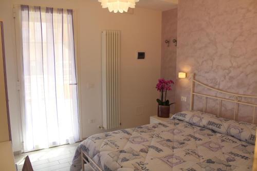 A bed or beds in a room at Affittacamere La Perla Del Conero