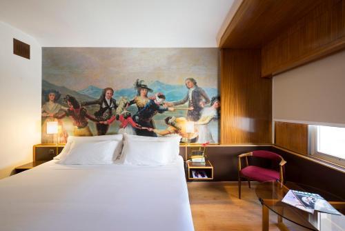 Cama o camas de una habitación en Hotel Goya