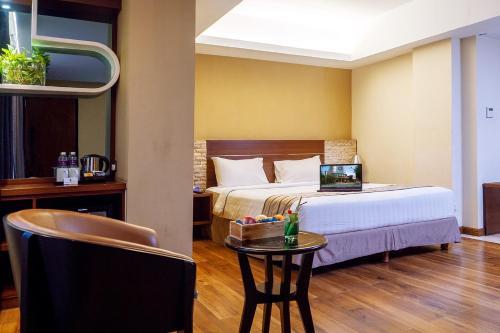 En eller flere senger på et rom på Da Vienna Boutique Hotel