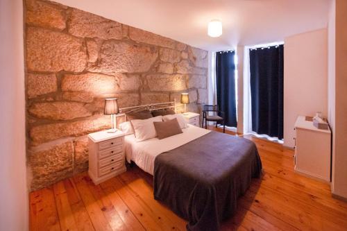 Uma cama ou camas num quarto em OportoHouse