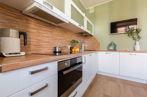 Кухня или мини-кухня в Семейные апартаменты