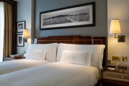 A bed or beds in a room at The Beaumont Hotel