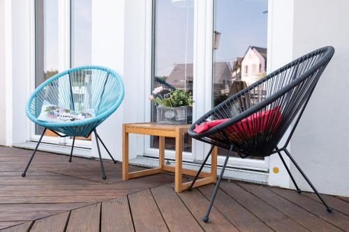 Ein Sitzbereich in der Unterkunft Hotel Café del Maar