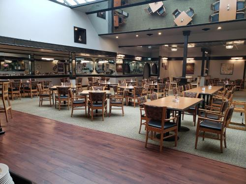 A restaurant or other place to eat at Baymont by Wyndham Red Deer