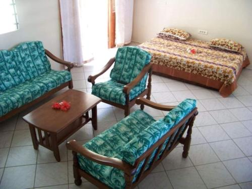 Uma área de estar em HUAHINE - Villa Tiare Tipanier (Tiarenui et Iti)