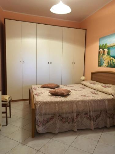 A bed or beds in a room at A due passi da Cala Pisana