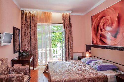 Кровать или кровати в номере Отель Камелот