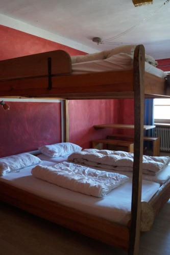 A bunk bed or bunk beds in a room at Schiff Bihlerdorf - Hostel