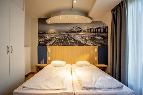 A bed or beds in a room at Hotel Paradisio by WP Hotels