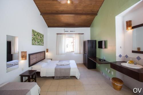 Cama ou camas em um quarto em Praia do Forte Hostel
