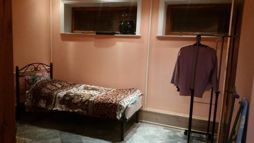 Кровать или кровати в номере Апартаменты Аленка на 7-й Садовой площадке, 1