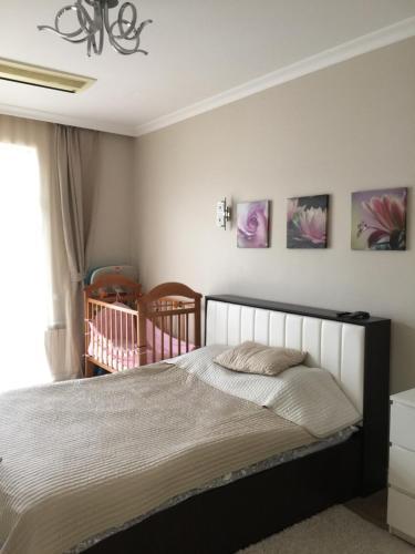 Кровать или кровати в номере Apartamenty v Akvatorii