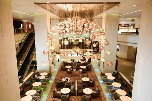 A restaurant or other place to eat at Pathumwan Princess Hotel - SHA Certified