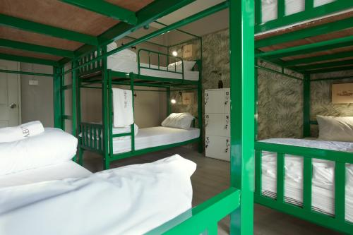 A bunk bed or bunk beds in a room at The Habitat Hostel Koh Chang