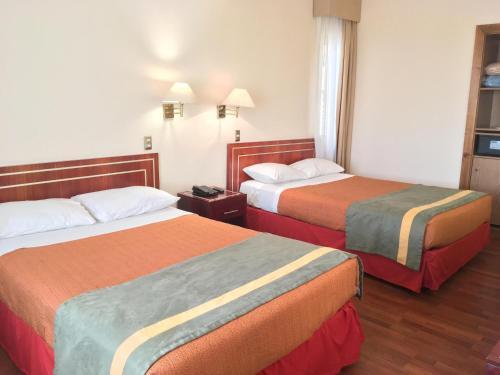 Cama o camas de una habitación en Hotel Francisco De Aguirre