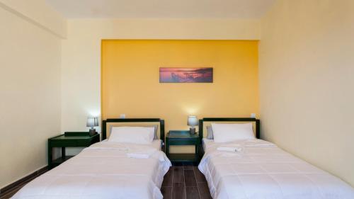 Ένα ή περισσότερα κρεβάτια σε δωμάτιο στο Fοivos and Athina Villas
