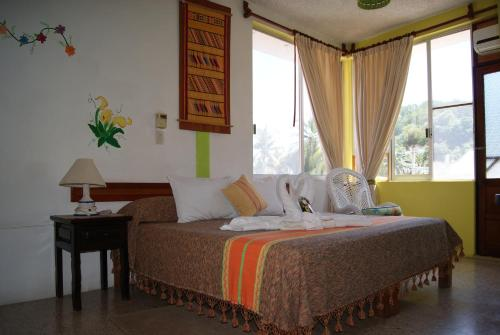 Cama o camas de una habitación en Hotel La Cabaña