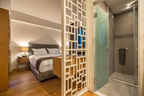 A bed or beds in a room at Glyfada Riviera Hotel