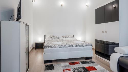 Letto o letti in una camera di Garden Apartment