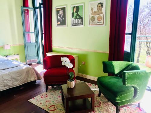 A seating area at Boutique Hotel Dobra Vila Bovec
