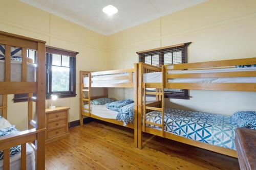 A bunk bed or bunk beds in a room at The Seamist Cottage