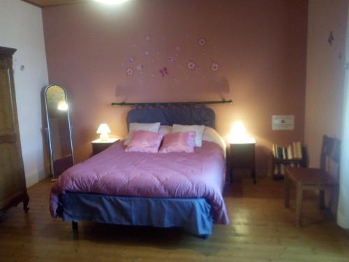 Un ou plusieurs lits dans un hébergement de l'établissement Gîte Chez Deplante
