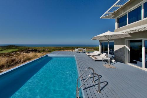 The swimming pool at or near Exclusive Golf Retreat by The Getaway Collection
