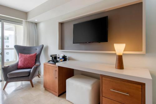 A television and/or entertainment center at Emotions Puerto Plata