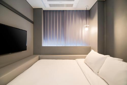 A bed or beds in a room at Hotel Cappuccino