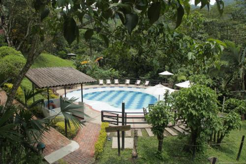 A view of the pool at Hotel La Selva Agroecologica or nearby
