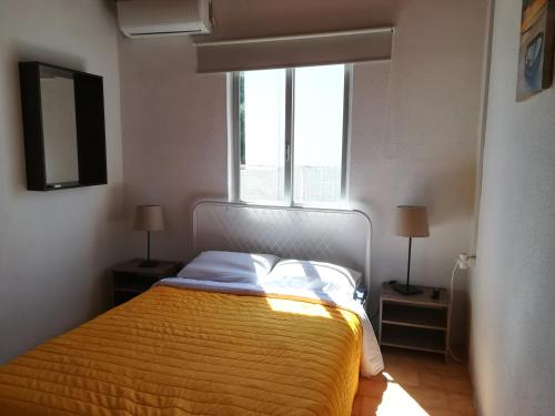 A bed or beds in a room at NAKI Vacation Rental