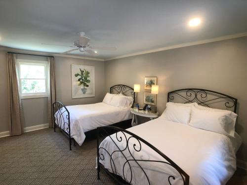 A bed or beds in a room at St. Francisville Inn