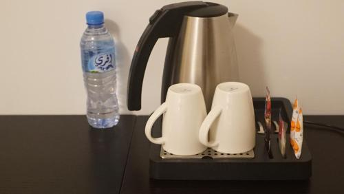 Coffee and tea-making facilities at Hotel Best Night 2