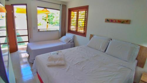A bed or beds in a room at Casa Corvina