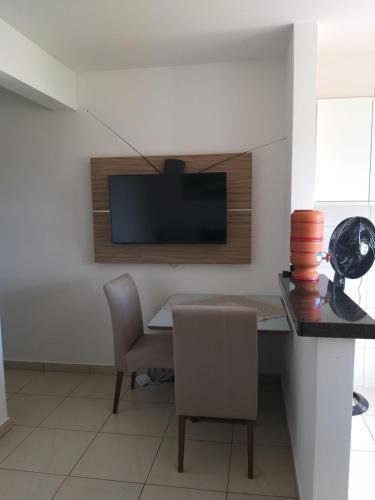 A television and/or entertainment center at Apartamento Cidade Verde 4