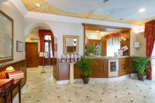 The lobby or reception area at Hotel Boccaccio