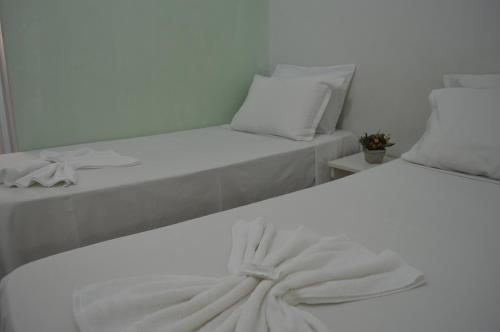 A bed or beds in a room at Touring Hotel
