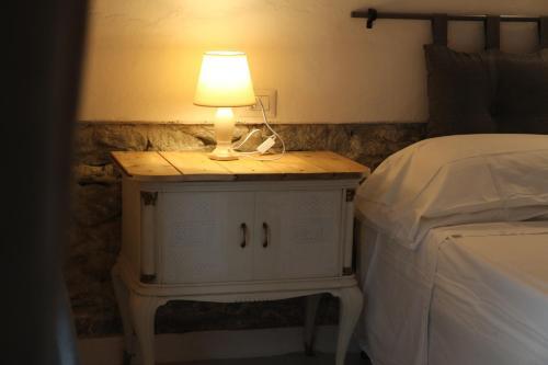 Letto o letti in una camera di Valdilimahouse