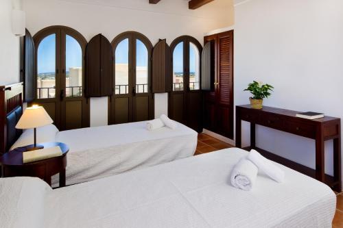 Un ou plusieurs lits dans un hébergement de l'établissement CAN NOVES - Villas de 4 suites (52)
