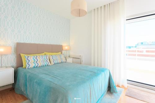 A bed or beds in a room at Nazare Marisol Praia