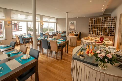 Een restaurant of ander eetgelegenheid bij Hotel Lido