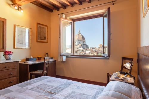 Letto o letti in una camera di Palazzo Graziani