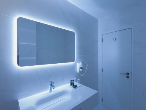 A bathroom at Lutecia Smart Design Hotel