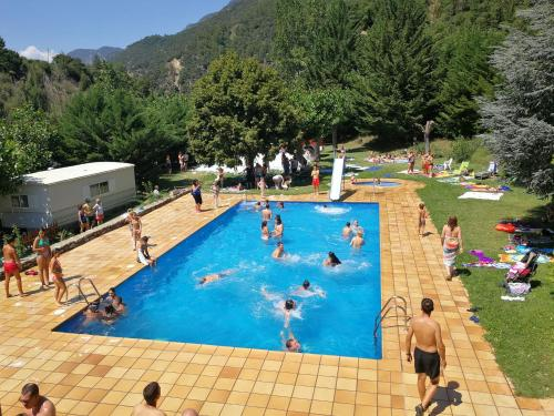 A view of the pool at Bungalows Pont d'Ardaix or nearby