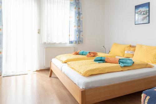 Ein Bett oder Betten in einem Zimmer der Unterkunft Pension Schließelberger