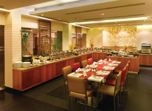A restaurant or other place to eat at Kenilworth Hotel, Kolkata